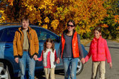 Car trip on autumn family vacation, happy mother and kids travel and have fun — Stock Photo
