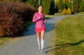 Woman running in autumn park, beautiful girl runner jogging outdoors — Стоковое фото