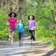 Family sport, happy active mother and kids jogging outdoors, running in forest — Stockfoto #75103683