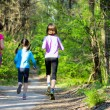 Family sport, happy active mother and kids jogging outdoors, running in forest — Stock fotografie #75103717