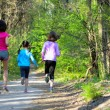 Family sport, happy active mother and kids jogging outdoors, running in forest — Stockfoto #75103781