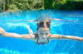 Happy child swims in pool underwater, active kid swimming, playing and having fun, children water sport — Stock Photo