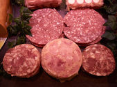 Selection of freshly cut salami — Stock Photo