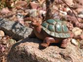 Stone turtle statue in a garden — Stock Photo