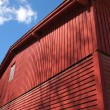 Red old wooden barn — Stock Photo #73633357