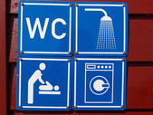 Blue sign of public toilets WC shower washing machines baby — Stock Photo
