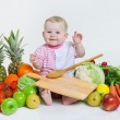 Cute baby sitting with fruits and vegetables — Stock Photo #65006439
