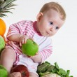 Cute baby sitting with fruits and vegetables — Stock Photo #69429993