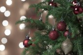 Christmas Ornament with Lighted Tree in Background — Stock Photo