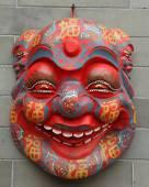 Chinese mask on wall — Stock Photo