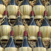 Chianti wine bottles — Stock Photo