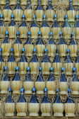 Wall made of many chianti wine bottles — Stock Photo