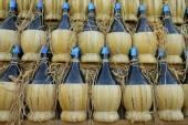 Chianti wine bottles — Stock Photo