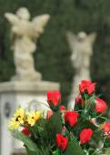 Bouquet on old cemetery — Stock Photo