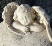 Sleeping little angel figurine — Stock Photo