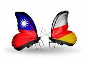 Butterflies with Taiwan and South Ossetia flags on wings — Stock Photo