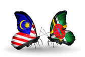 Butterflies with Malaysia and Dominica flags on wings — Stock Photo