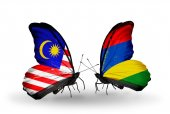 Butterflies with Malaysia and Mauritius flags on wings — Foto Stock