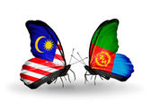 Butterflies with Malaysia and Eritrea flags on wings — Stock Photo