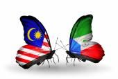 Papillons avec des drapeaux de Malaisie et de la Guinée équatoriale sur les ailes — Photo