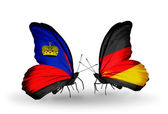 Butterflies with Liechtenstein and Germany flags on wings — Stock Photo