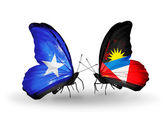 Butterflies with Somalia and Antigua and Barbuda flags — Foto de Stock