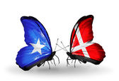 Butterflies with Somalia and Denmark flags — Stock Photo