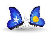 翼にソマリアとパラオのフラグと蝶 — ストック写真