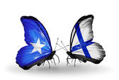 Butterflies with Somalia and Finland flags — Stock Photo