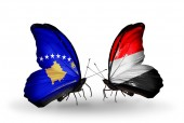 Butterflies with Kosovo and Yemen flags — Stock Photo
