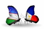 Butterflies with Uzbekistan and Philippines flags — Stock Photo