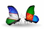 Butterflies with Uzbekistan and Eritrea flags — Stock Photo