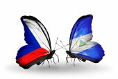 Butterflies with Czech and Nicaragua flags — Stock Photo