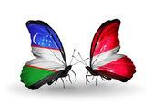 Butterflies with Uzbekistan and Latvia flags — Stock Photo