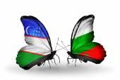 Butterflies with Uzbekistan and Bulgaria flags — Stok fotoğraf