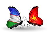 Butterflies with Uzbekistan and Vietnam flags — Stock fotografie