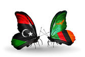 Butterflies with  Libya and Zambia flags — Stock Photo