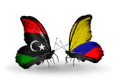 Butterflies with Libya and Columbia flags — Stock Photo