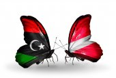 Butterflies with  Libya and Latvia flags — Stock Photo