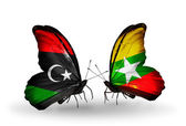 Butterflies with Libya and Myanmar flags — Stock Photo