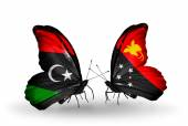 Butterflies with Libya and Papua New Guinea flags — Stock Photo