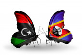 Butterflies with Libya and Swaziland flags — Photo