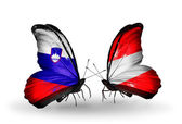 Butterflies with Slovenia and Austria flags — Stock Photo