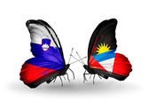Butterflies with Slovenia and Antigua and Barbuda flags — Stock Photo