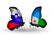 Butterflies with  Libya and Djibouti flags — Stock Photo