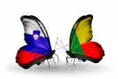 Butterflies with Slovenia and Benin flags — Stock Photo