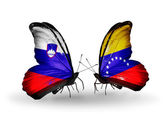 Butterflies with Slovenia and Venezuela flags — Stock Photo