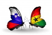 Butterflies with Slovenia and Ghana flags — Stock Photo