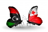 Butterflies with Libya and Tonga flags — Stock Photo