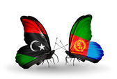 Butterflies with  Libya and Eritrea flags — Stock Photo